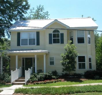 2 Story home with metal roof and vinyl siding