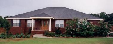 Traditional brick home with columns