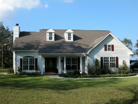 Vinyl siding with dormers which provide light into the home.