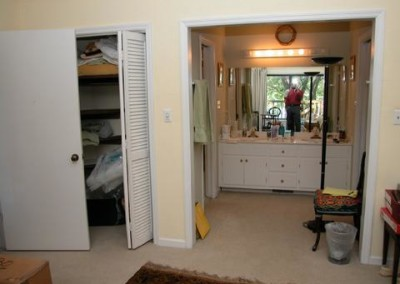 View from bedroom at small closet and the old vanity
