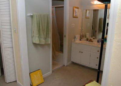 Looking into the tub area and vanity