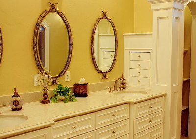 Vanity with oval mirrors and inset cabinet