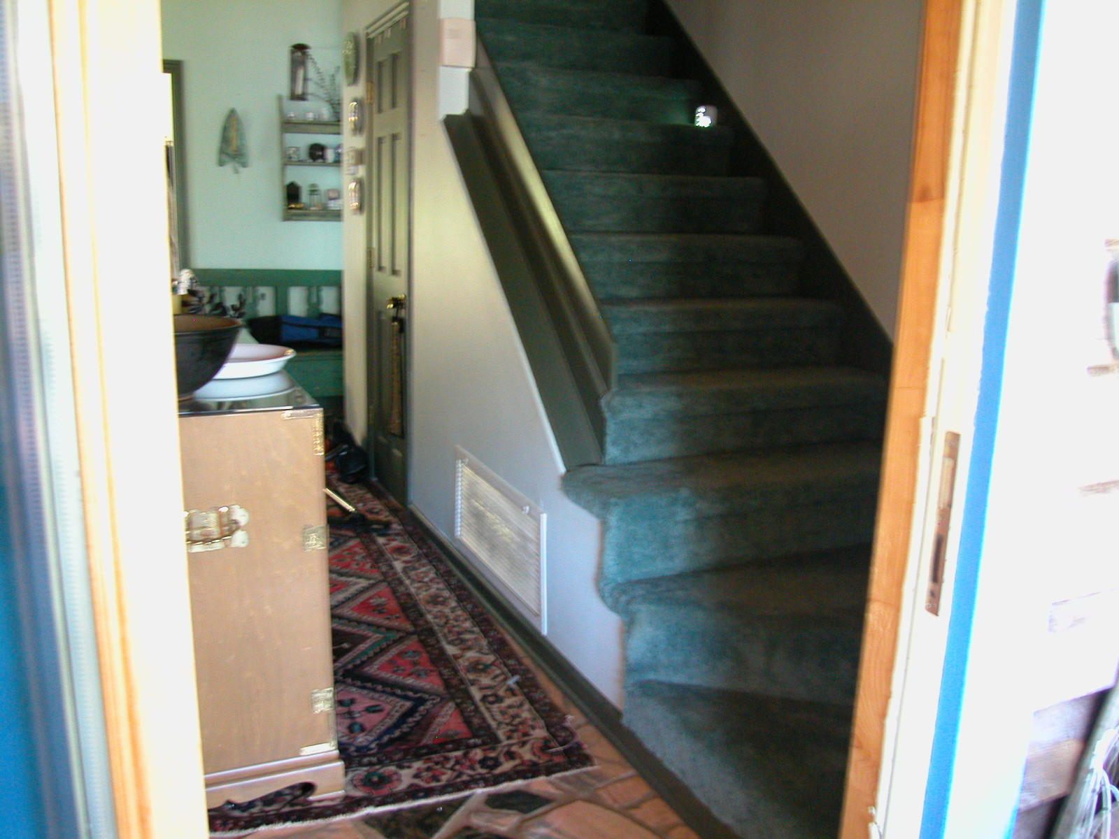 Existing stairs prior to remodeling, carpet and no handrails
