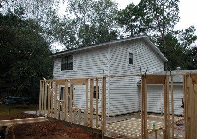 Back of the house with a few new walls framed